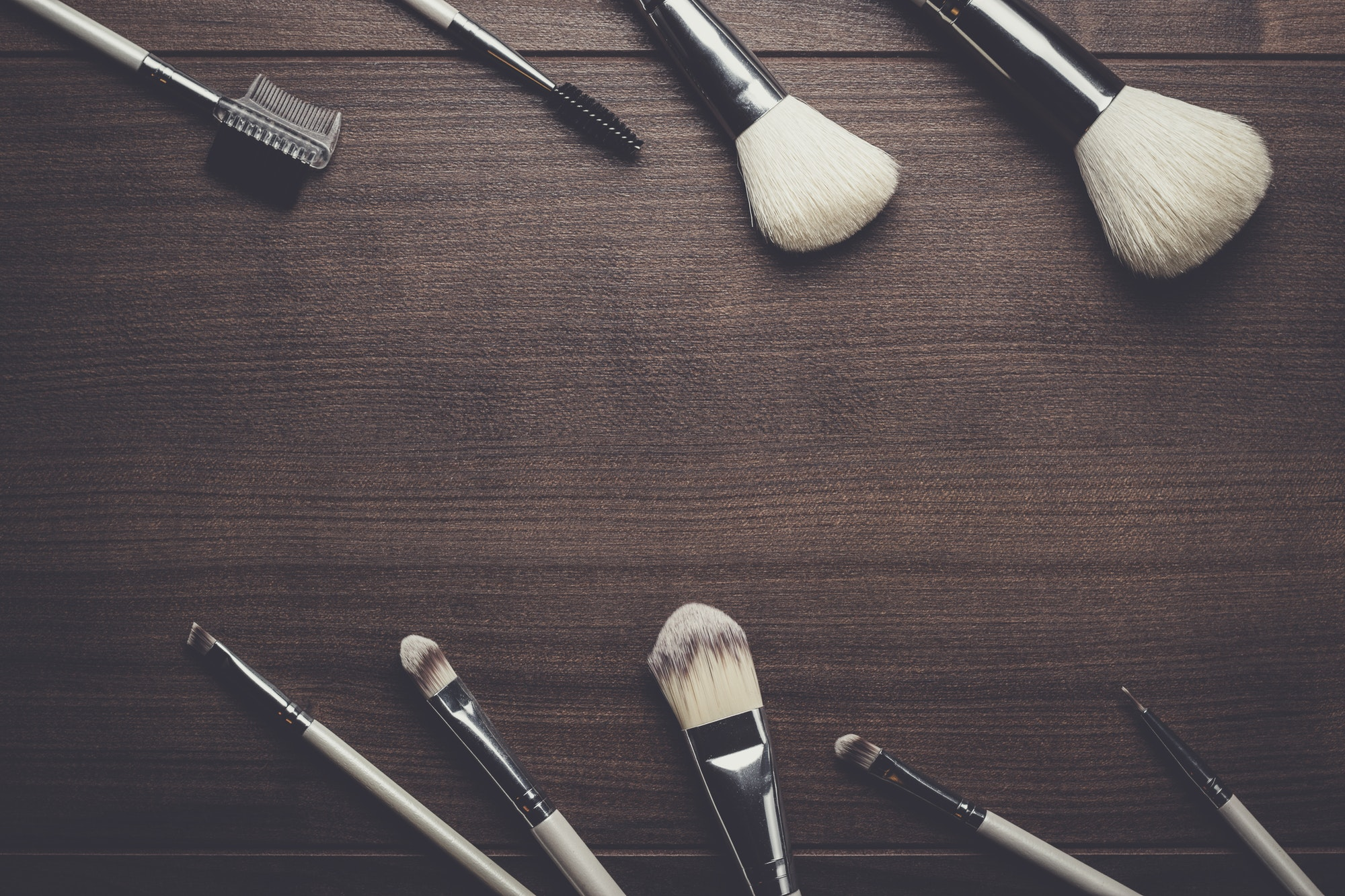 make-up brushes on wooden background