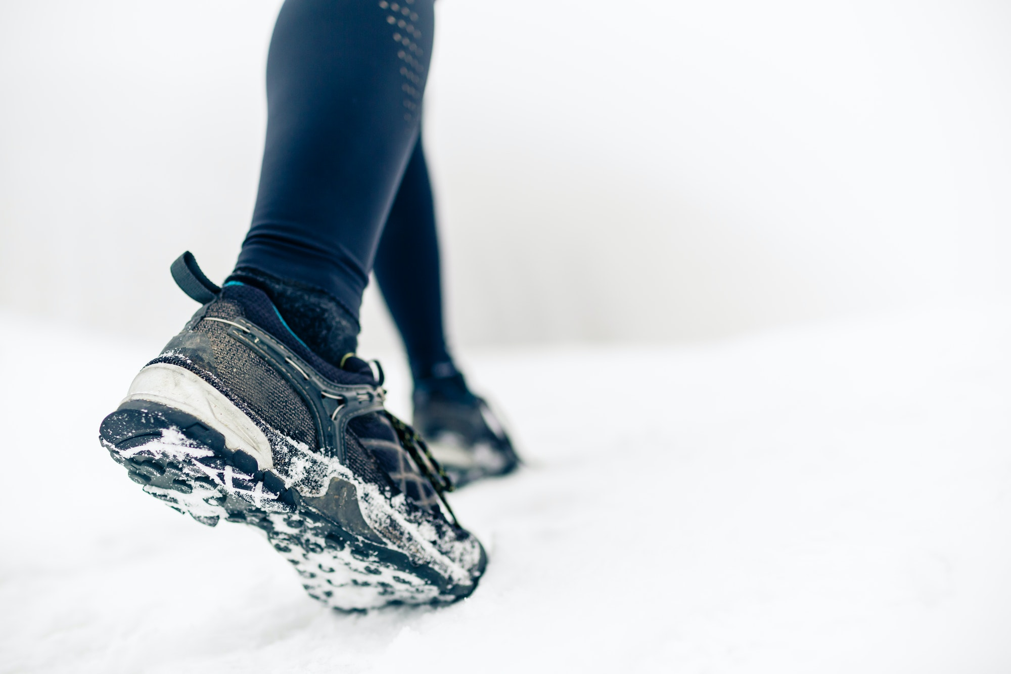 Hiking or walking shoes on snow, winter mountains